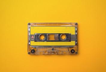 audio cassete on yellow background