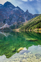 Fotobehang Bergen Colorful dusk at pond in the Tatra Mountains in autumn
