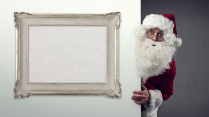Santa Claus and decorative frame