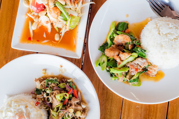 stir-fried pork and herb with rice, Stir fried kale and crispy pork with rice, papaya salad or Som Tum, Thai food