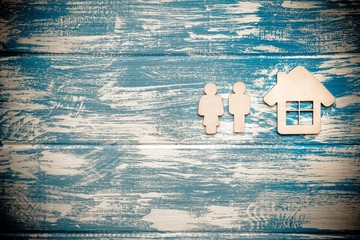 Symbol of home and family on a blue wooden background