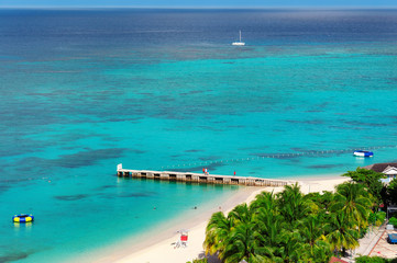 Foto auf Leinwand Karibik Aerial view on beautiful Caribbean beach and pier in Montego Bay, Jamaica island.