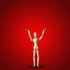 Wooden Mannequin holds hand up on red background
