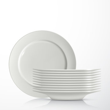 Stack of white ceramic plates, isolated on white