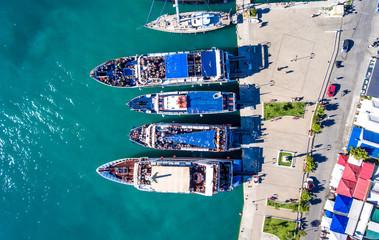 Tourists embarking on daily cruise ships in Nikiana Lefkada Greece