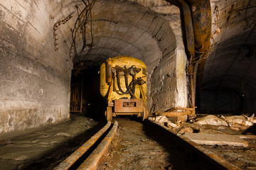 Underground abandoned ore mine shaft tunnel gallery cart wagon for explosives