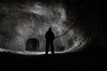 Underground mine shaft copper ore tunnel gallery with miner