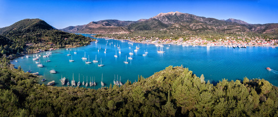 Nydri (Nidri) town in Lefkada Greece Ioanian Island bay panorama yachts and clear blue water in the summer