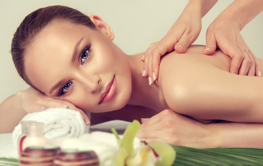 Massage and body  care. Spa body massage treatment. Woman having massage in the spa salon for beautiful girl . massage woman hands