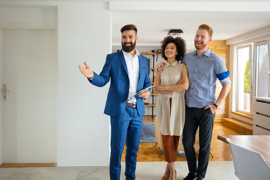 Young couple looking new home with agent
