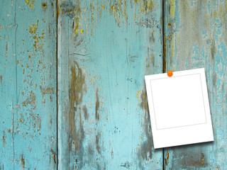 Blank square photo frame on old blue weathered wooden boards background