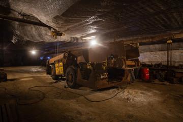 Underground mine shaft iron ore tunnel gallery with machine transport