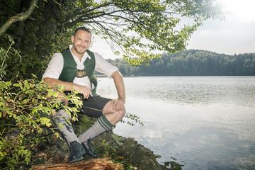 bavarian tradition man at the lake