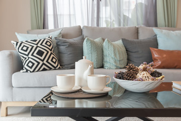 set of tea cup on tray in modern living room