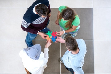 Startup business people assembling jigsaw puzzle, team support, concept, diversity
