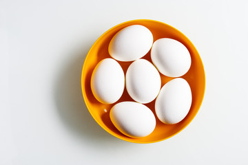Still life of six white eggs in a bowl