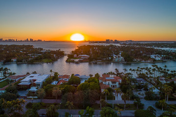 Aerial image of a beautiful sunset Miami Beach homes islands water