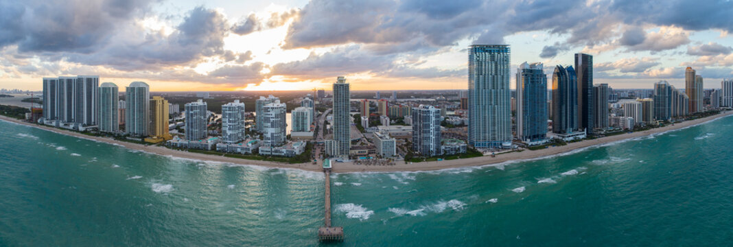 Aerial image Sunny Isles Beach FL pier and sunset