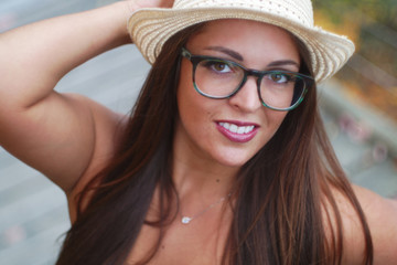 young woman wearing hat and glasses portrait beautiful girl close-up