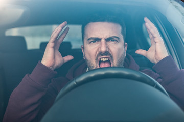 Rude man driving his car and arguing