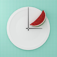 Top view of Watermelon half on white round plate in a form of clock on point pattern blue background. Food health concept diet decision. minimal food creative arrangement,