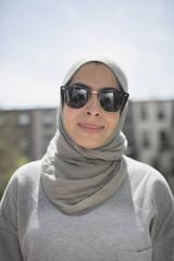 Muslim woman wearing a hijab and sunglasses