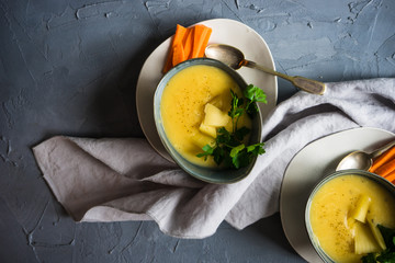Cheese soup on concrete background
