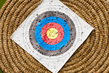 Shooting target and bullseye with many bullet holes