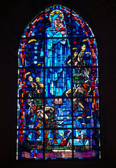 Memory to paratrooper who landed on church of Sainte-Mère-Église on D-Day in Stained glass in same church