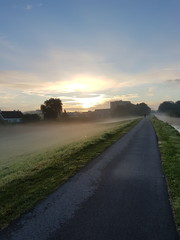 Morning fog over the dyke in nieuwerkerk aan den IJssel in the Netherlands