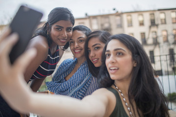 Young women taking a selfie at a party together