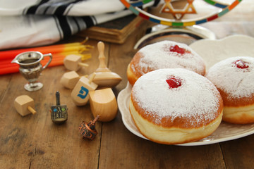 image of jewish holiday Hanukkah background with traditional spinnig top, doughnuts and menorah (traditional candelabra).