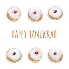 jewish holiday Hanukkah image with traditional doughnuts isolated on white.