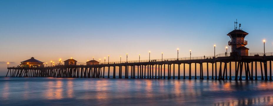 The Huntington Beach Pier in Huntington Beach at twilight sunset glow