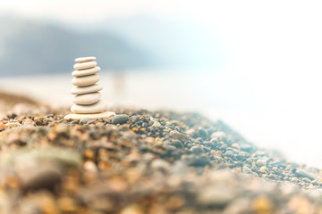 pyramid pebbles   background  sea and mountains
