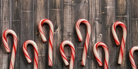 Christmas Candy cane frame on rustic wooden background with copy space