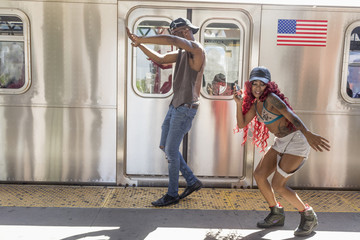 Couple dancing beside a train