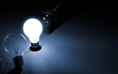 Glowing Lightbulb in between off Lightbulbs