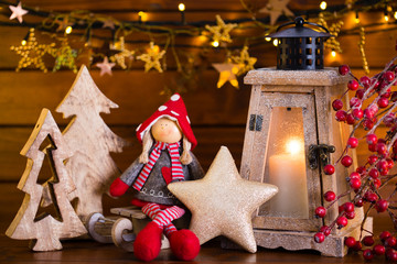 Christmas background with lantern light and decor.