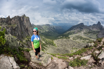 View of a girl hiking in the Ergaki mount, Russia