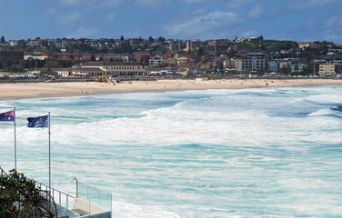 Blue flags and beach arc at Bondi Beach in Sydney, Australia
