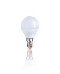 LED light bulb isolated on white background with reflection