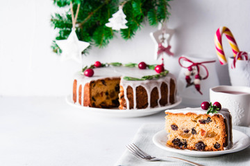 Christmas fruit cake, pudding on white plate. Copy space.