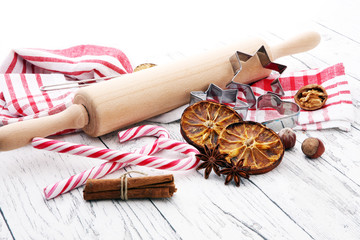 Ingredients for Christmas baking - spices, nuts, cookies and shape cookie cutters. Seasonal, food background