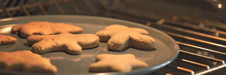 Gingerbread cookies on baking tray in oven