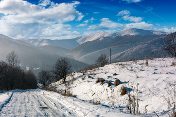rural road in snowy mountainous area