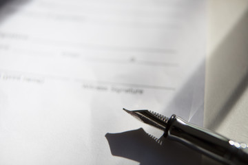 Close-up of Contract form with open fountain pen
