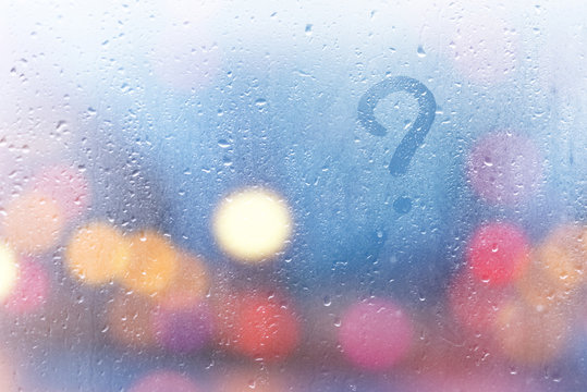 Rainy weather, the inscription on the sweaty glass question mark.
