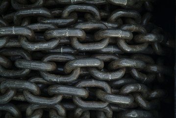 Keuken foto achterwand Schip Anchor Chain on a Roll. This piece of chain makes an interesting texture when rolled up on the bow of a fishing boat in southeast Alaska.