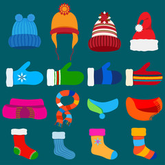 Set of Christmas warm winter clothes in flat style on blue background